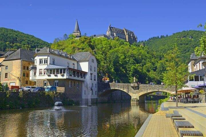 The beautiful medieval castle in Vianden, a small village in Luxembourg and embankment on the Our river.